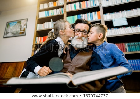 portrait of a Happy Boy Kissing Happy granddad Stock photo © galitskaya