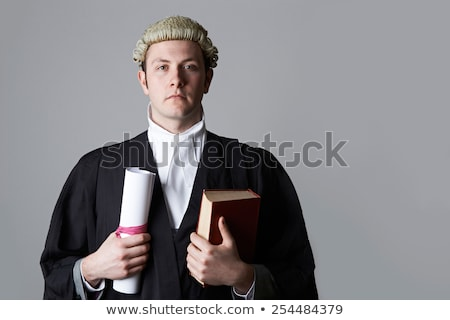 Studio Portrait Of Lawyer Holding Brief And Book Stock photo © HighwayStarz