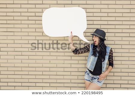 beautiful fashion teen in front of a brick wall. Stock photo © Lopolo