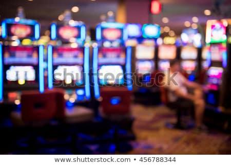Slot Machine and Happy Gambler with Money Casino Stock photo © robuart