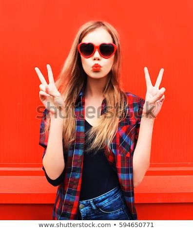 happy teenage girl in red heart shaped sunglasses Stock photo © dolgachov