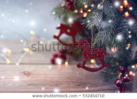 Noel ahşap oyuncak at sallanan ağaç ışık arka plan Stok fotoğraf © Melnyk