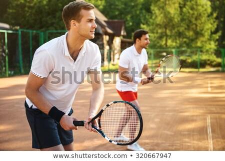 Kép jóképű férfi játszik teniszpálya kint sportruha Stock fotó © deandrobot