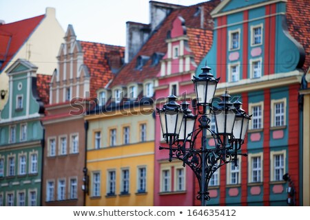 Multi-colored houses at the market square Stock photo © elxeneize