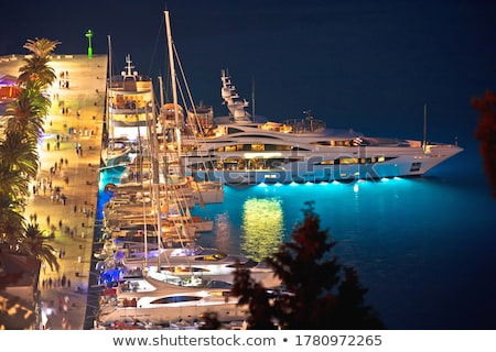 Hvar bay and yachting harbor aerial panoramic evening view Stock photo © xbrchx
