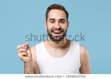 Man Cleaning Ear With Swab. Stock photo © cteconsulting
