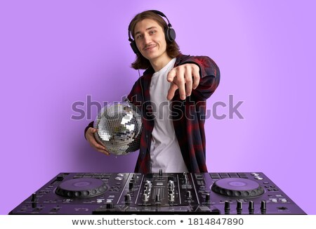 Young attractive disc jockey wearing headphones Stock photo © aladin66