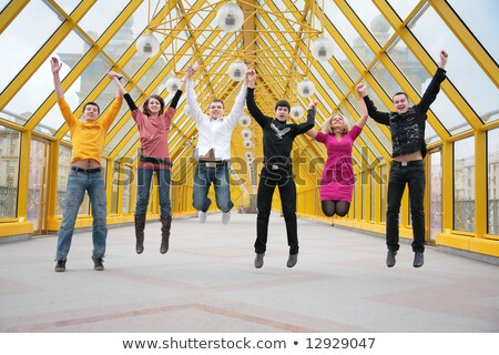 group of friends jump on footbridge taking as hands stock photo © paha_l