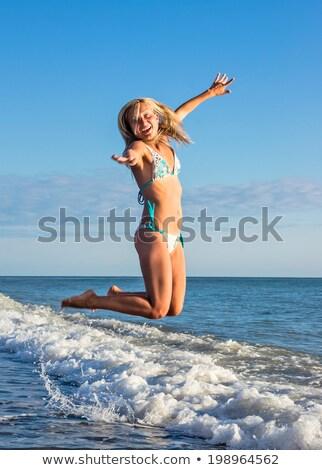 Fille maillot de bain battant cheveux femme sourire Photo stock © Paha_L