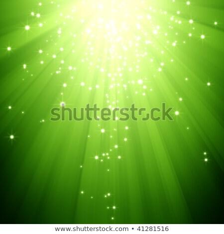 Glitter Stars Descending On Green Light Burst Photo stock © MeiKIS