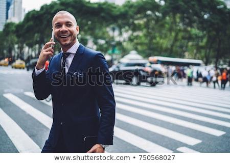 Businessman having phone conversation outdoors Stock photo © photography33