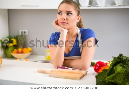 young woman wondering what to cook Stock photo © photography33