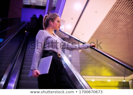 Woman listening to music stored in her laptop Stock photo © photography33
