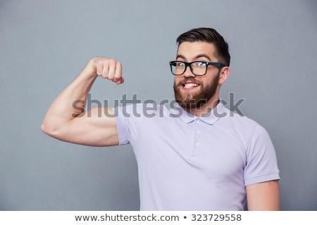 jovem · caber · cara · bíceps · toalha - foto stock © stockyimages