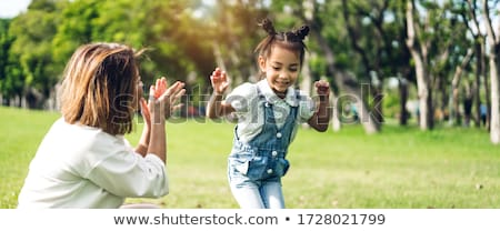 woman and child have fun outdoor Stock photo © dotshock