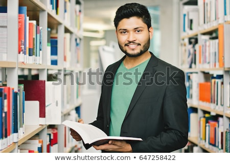Young guy with book Stock photo © MikLav