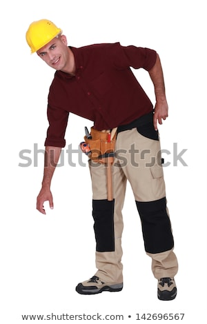 Tradesman bending over to pick something up Stock photo © photography33