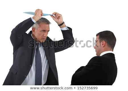 Angry boss about to hit employee with clip-board Stock photo © photography33
