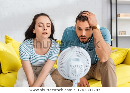 Handsome young couple sitting  stock photo © danielkrol