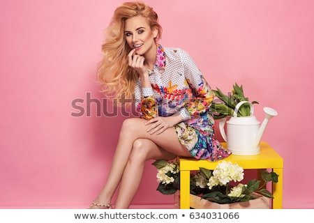 portrait of delicate blonde woman on yellow background stock photo © danielkrol