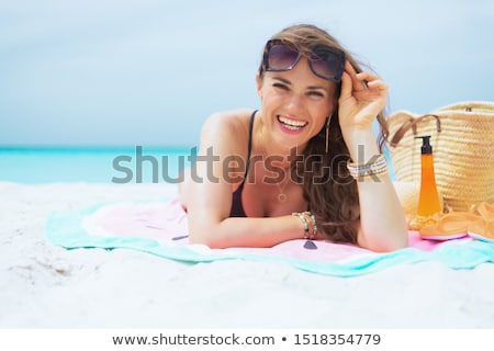 Stock photo: Woman with a towel and suncream