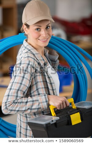 Woman with blow-torch and copper pipe Stock photo © photography33