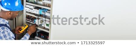 Man fixing fuse box Stock photo © photography33
