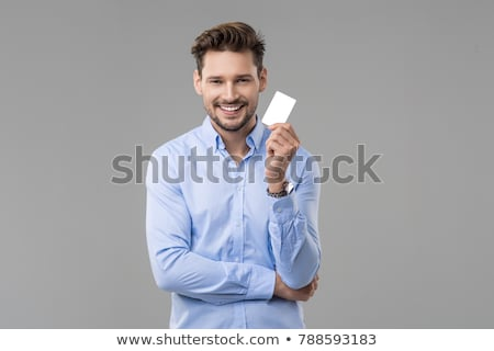 Excited man holding business card Stock photo © photography33