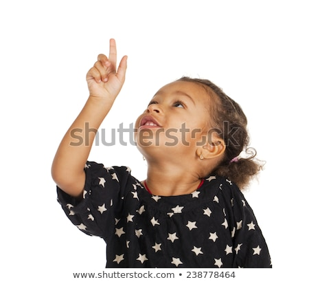 Smiling young child looking up and pointing Stock photo © stockyimages