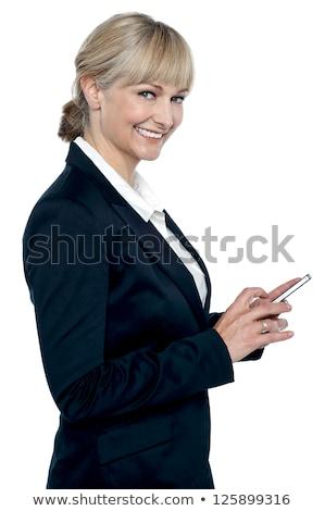 Női igazgató érintőképernyő mobiltelefon mosolyog kamera Stock fotó © stockyimages