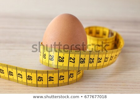 egg and measuring tape stock photo © luapvision