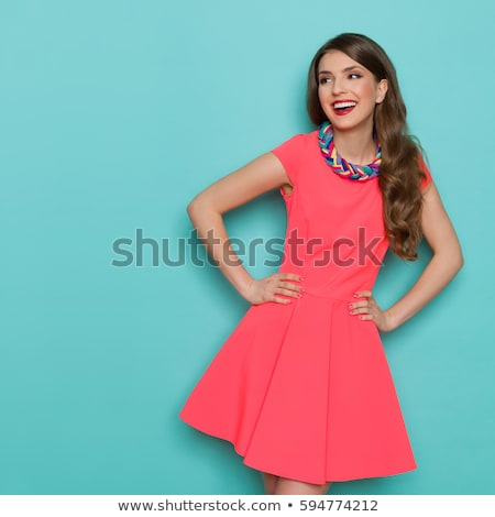 Attractive smiling woman with beauty long brown hair - posing at Stock photo © Victoria_Andreas