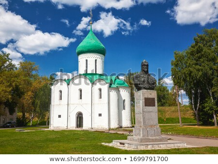 Stock photo: Stone sculpture and church in Yaroslavl, Russia.