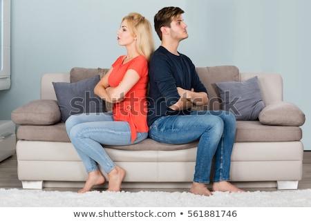Sofá brigar mulher amor preto Foto stock © dacasdo