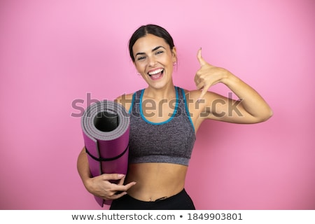 Young Woman Showing Rocker Sign With Her Fingers Stock photo © williv
