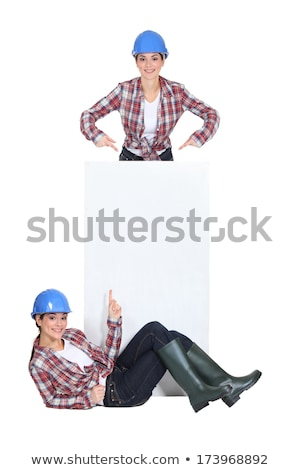 twosome of jovial girls with blue hard hat Stock photo © photography33
