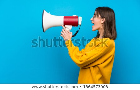 Teenagers shouting through megaphone Stock photo © get4net