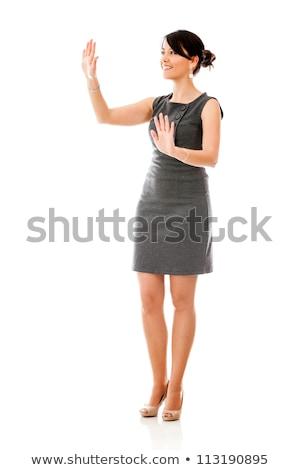 Zakenvrouw aanraken iets denkbeeldig studio portret Stockfoto © stepstock