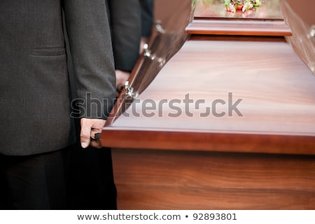 coffin bearer carrying casket at funeral Stock photo © Kzenon