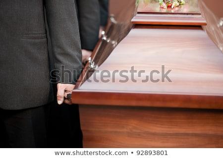 coffin bearer carrying casket at funeral stock photo © kzenon