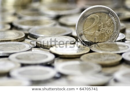 Grungy 2 euro coin with coins on background Stock photo © Kirill_M