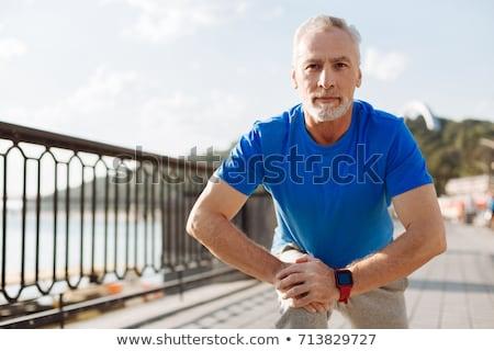 Actief volwassen man fitness geïsoleerd witte familie Stockfoto © AndreyPopov