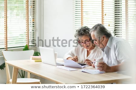 Stock photo: Worried Senior Couple Using Laptop At Home