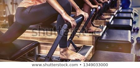 Pilates reformer workout exercises women Stock photo © lunamarina