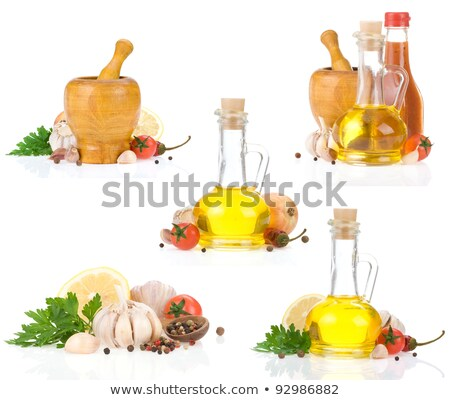 olive oil onions and mortar on black stock photo © marimorena
