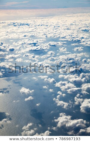 Earth view from above with clouds and sea reflections Stock photo © slunicko