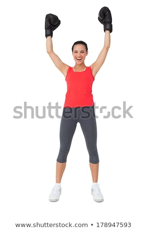 Full length portrait of a happy boxer standing over white background Stock photo © deandrobot