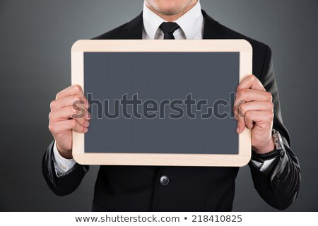 Midsection Of Businessman Holding Blank Slate Stock photo © AndreyPopov