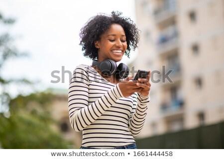 retrato · jovem · mulher · negra · ao · ar · livre · praia · mãos - foto stock © BrazilPhoto