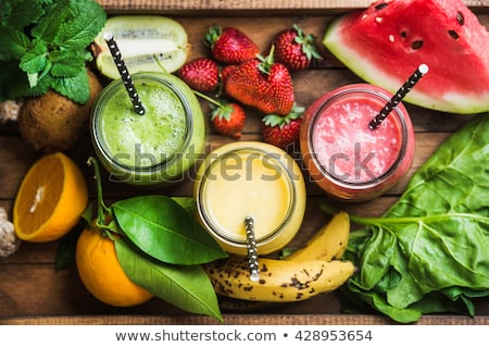 A green smoothie on a tray with kiwi Stock photo © Zerbor